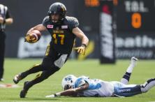 Hamilton Tiger-Cats' Luke Tasker evades a tackle by Toronto Argonauts' Branden Smith (R) during the first half of their CFL football game in Hamilton, Ontario, Canada, September 7, 2015. REUTERS/Mark Blinch TPX IMAGES OF THE DAY